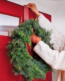 Suspend your holiday wreath from the top of the door frame and avoid making unsightly holes.