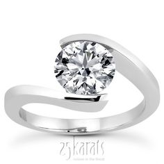 Round Cut Tension Set Solitaire Engagement  Ring. This ring can be set with 0.33 ct. - 1.35 ct. range round cut center diamond. Available in 14K gold, 18K gold, Palladium & Platinum. / Style Number : ENR5740