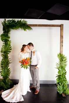 This couple chose tropical plants like fronds and birds of paradise to set the vibe for their paradise wedding.