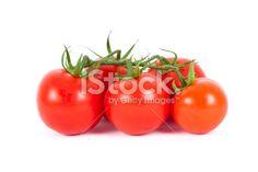 Tomatoes on the vine Photo libre de droits