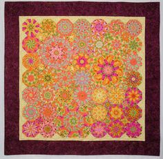 """Fiesta,"" 54"" x 54"", by Dawn White of First Light Designs (2009). Based on Judy Johnson's ""Cascading Kaleidoscopes"" design. Quilted by Lee Fowler."