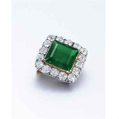 The square-shaped emerald within an old mine and European-cut diamond surround, mounted in 18k gold and silver, circa 1780