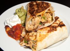 Pan-fried Burritos stuffed with Rotisserie Chicken, Black Beans and Cheese... yum!