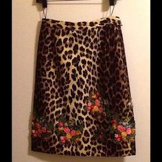 REPOSH Moschino CheapandChic Leopard Pencil Skirt This is my favorite skirt, and although I can wear a Size 4, unfortunately I keep forgetting how snug pencils are on my shape .  (Sorry my PFF) Whether it's cheetah or leopard print, it's drop dead gorgeous, with embroidered floral appliqués around the hem.  Photo #1 is the front view, and Photo #2 is the back.  Waistband and invisible side zipper.  This skirt has been worn, but it looks brand new.  The quality is that good !!  It would have ...
