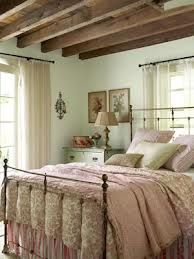 Cozy with the soft colors, exposed beams - love the bed frame and wall color