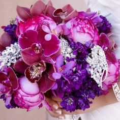 Bridal bouquets designed using pretty brooches and flowers. The best of both worlds!