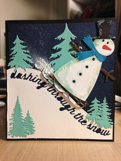 Snowman dashing through the snow on a sled: QuicKutz, Memory Box and Impression Obsession dies