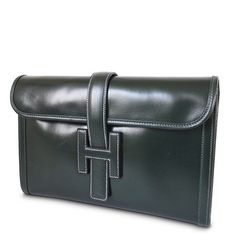 Hermes Box Calf Jige Pm Dark Vintage Green Clutch. Get the trendiest Clutch of the season! The Hermes Box Calf Jige Pm Dark Vintage Green Clutch is a top 10 member favorite on Tradesy. Save on yours before they are sold out!