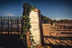 Couple's Colorful Ceremony Sign |   Photography: Juan Carlos Tapia Photography.   Read More:  http://www.insideweddings.com/weddings/rustic-destination-wedding-with-touching-details-on-beach-in-mexico/801/