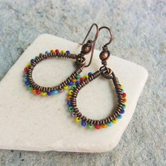 Colorful Seed Bead wire wrapped teardrop hoop earrings with fiesta mix seed beads Seed Bead Earrings, Copper Earrings, Beaded Earrings, Seed Beads, Beaded Jewelry, Hoop Earrings, Metal Jewelry, Pearl Necklace, Ceramic Jewelry