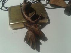 Walnut deer pendant.