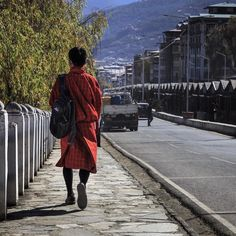 It's heartening to see a majority of Bhutanese men wear their traditional dress Gho. The blend of modernism (e.g. gel styled funky hairdo) & traditional attire surprised me & left me smiling more than once. . . . . . . . . #Times2Travel #Bhutan #latergram #Thimpu #traditional #tradition #attire #dress #men #blend #fashion #streetstyle #street #streetphotography #lifestyle #photooftheday #Canon #travel