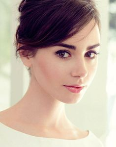 Lily Collins is stunning. I chose this makeup look because it is a natural and classy look. Her make up is very fresh looking. I love how the makeup enhances her features. This would be a great every day makeup look.