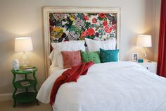 DIY Headboard with molding, foam/stuffing and pretty fabric. Oh and of course a staple gun :)