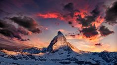 Amazing Matterhorn - Is not a realistic landscape, is a little playing with photoshop. :) i like it.  edit: the lights on the Matterhorn and the mountains a realistic, original. i have make this shot on a sunrise. the clouds are not realistic, clouds/sky edit with topaz clarity and photoshop levels (dt. tonwertkorrektur.)