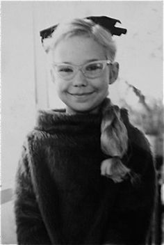 bless - Stacy Rae was a 7-year-old Beatnik in a black cowl sweater that made her feel sophisticated when she wasn't quite sure what a Beatnik was. She only knew her parents didn't like them. She wasn't allowed to have long hair, so a fake ponytail added another element of the forbidden to this snapshot.