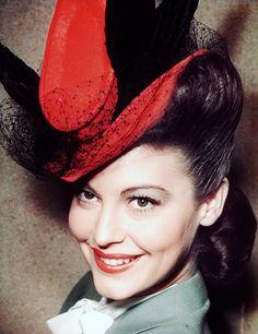 Grey days need Ava Gardner in a jaunty red hat.