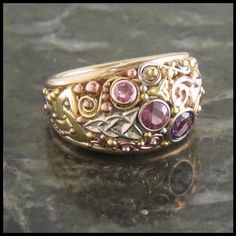 14K Yellow Gold frames with 14K Rose Gold, 14K White Gold and 18K Yellow Gold details, set with an ombre of stones. This ring is still currently available for sale. Can be sized. Made in USA Click her