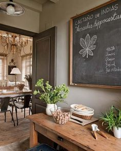gold framed chalkboard. wooden table. metal chairs.  i love this color combo