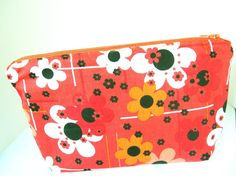 Check out this item in my Etsy shop https://www.etsy.com/listing/486007944/orange-and-black-floral-cosmetic-bag