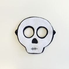 Here's a spooky, scary Skeleton Mask for your Halloween Fun!Each mask is made from layers of Eco-fi Felt sewn together to ensure a high-quality product for your child to enjoy for hours upon hours of playtime!Masks fit kiddos with a comfy elastic strap that sits above the ears, around the back of the head. Please use caution when giving masks to young children. Copyright 2014 :: Opposite of Far, LLC