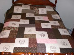 Quilt embellished with machine embroidery blackwork designs.