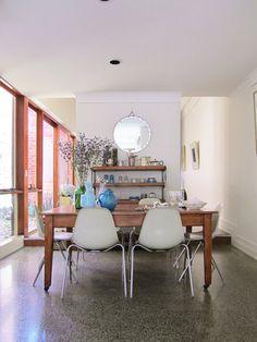 Rustic table, modern chairs. Round mirror. #DesignSponge