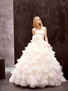 7dc4052569f9 White by Vera Wang Halter ball gown with draped bodice and tulle petal  skirt. Ball gown features halter neckline, draped taffeta bodice, and full  skirt made ...