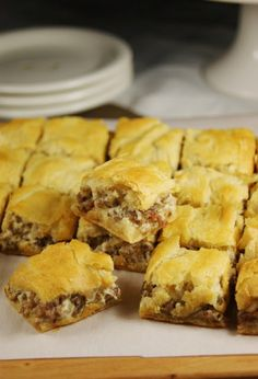 Crescent Sausage Bites ~ 3-ingredient super simple party favorite! Sausage, Cream Cheese, 2 Crescent Rolls! One roll on the bottom of baking dish, brown sausage, stir in cream cheese, put in baking dish, top with 2nd crescent roll. 375 for 20 min! Yum!