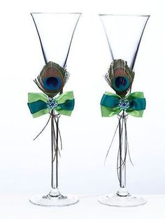 Gorgeous Jeweled Peacock Feather and Satin Ribbon Wedding Toasting Flutes
