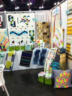 Modern Quilt Relish booth Houston Quilt Market 2013, Picnic book at the back, Cutlery and Torte patterns at far right