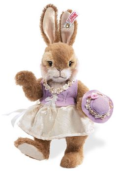 Steiff Valentina Rabbit. Limited Edition. Beautifully made collector's item. Soft, cuddly and oh so pretty in her lavender dress and hat.