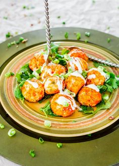 These Crockpot Buffalo Chicken Meatballs with Blue Cheese Dressing are spicy and delicious, yet super healthy. Perfect for an appetizer or a snack.