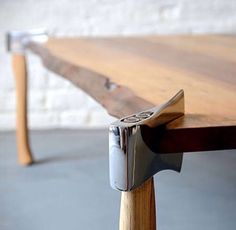 Axes as table legs for a rustic table - brilliant woodworking idea! I would want to use vintage/worn axes.