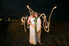 wedding sparklers for this destination wedding in Hawaii. Photography by Bob Brown from hawaiiphotographer.com