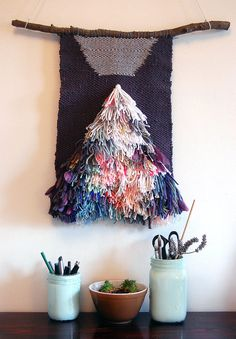 Mountain Falling Woven Tapestry created by Liz Toohey Wiese. Mixed wool and cotton hanging from a pine branch. One of a kind. I love loom work!