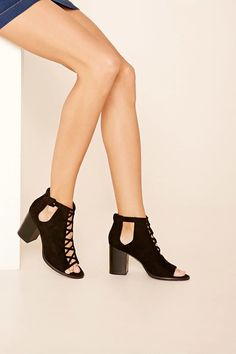 fba9e71e17a A pair of faux suede low platform wedge sandals featuring a buckled ankle  strap.