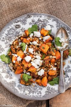 This Roasted Butternut Squash with Spiced Lentils, Feta and Pine nuts is a beautiful vegetarian meal that will not make you miss meat one bit!