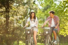 Young couple riding bicycles royalty-free stock photo