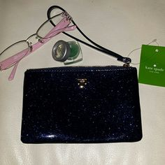 NWT Kate Spade Midnight Glitter Bug Wristlet Sparkly and just the right size for a night on the town. This wristlet is 4 ? 6 with strap that zips wristlet shut. Inside is polka dot grey and white. kate spade Bags Clutches & Wristlets