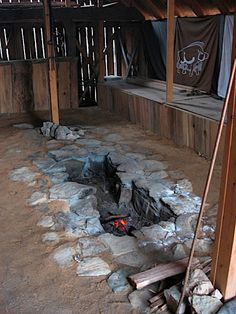"""Long Hall with fire pit. Perhaps for outdoor winter parties... Of course, I think the walls might need to be a bit tighter, and the whole building temporary, so as not to piss off """"the man."""" Or the neighbors."""