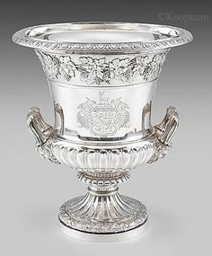 An Elegant George IV Wine Cooler Silver London, 1824 Maker's mark of Paul Storr Fully hallmarked to the body Height: 28.9cm, 11.3in Weight: 2,643g, 85oz The coat-of-arms are those of Townsend impaling those of Pechell, as born by the Rev. Henry Townsend of Honington Hall, Warwickshire, who married on 5th March 1811 to Catherine Anne, 3rd daughter of Sir Paul Perchell, 1st Bt.