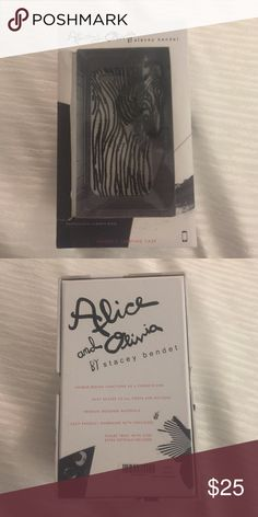 Alice & Olivia Zebra iPhone 5 Carrying Case NEW IN BOX. Alice & Olivia by Stacey Bendet Zebra Carrying Case for an IPhone 5. White enamel case with black black crystal detail and zebra head. Perfect for carrying. Statement piece. Alice + Olivia Accessories Phone Cases