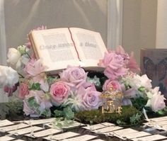 Card table ensemble for fairy tale wedding on top of a grand piano.