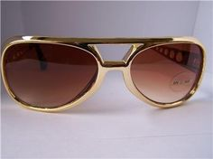 Elvis Kill Bill Sunglasses Gold Frame Brown Lens 100 % UV Protection Brand New . $4.32. Great Sunglasses for ELVIS fans... also great sunglasses just for fun These are the most authentic ELVIS STYLE sunglasses in the market. These glasses are brand new and are in fashion right now. These are unisex and suit anyone THESE SUNGLASSES PROVIDE 99.99% PROTECTION FROM HARMFUL UVa and UVb sunrays