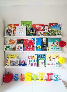 A coluorful shared kids bedroom. Ikea Ribba Shelves hack.