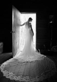 Cara's bespoke wedding veil inside barn