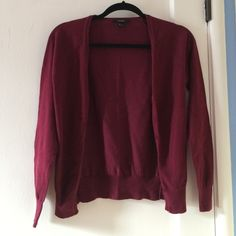 Maroon cardigan Long sleeved maroon cardigan with buttons. No holes or rips. Size small but it shrunk when I washed it so it fits more like a xs. Worn once. Not from brandy Brandy Melville Sweaters Cardigans