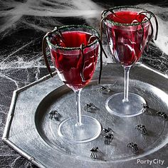 Dare to try this creepy crawly concoction: a Black Widow, crawling with creepy spiders! Click for the Halloween drink recipe. (Halloween Cocktails Black)