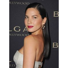 """This is no basic blowout. Sleek and glossy, Munn's look requires a little serum—and a lot of arm strength. """"It's all about the blow-dry,"""" Cranford says. """"The hairline needs to be really clean, and the part really straight."""